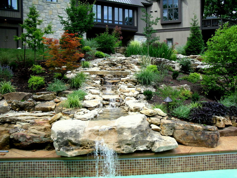 designscape, bloomington, nashville, columbus, landscaping, mowing, hardscaping, maintenance, irrigation, design, tree farm, specimen trees, waterfalls, water features, mower, sales, landscape architect, construction, carpentry, masonry, best rated company, award winning, consulting, patios, pavers, natural stone, outdoor kitchens, retaining walls, fire pits, lake Monroe, cabins